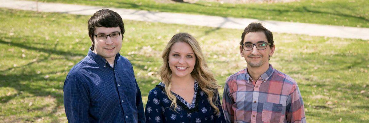 three smiling interns.